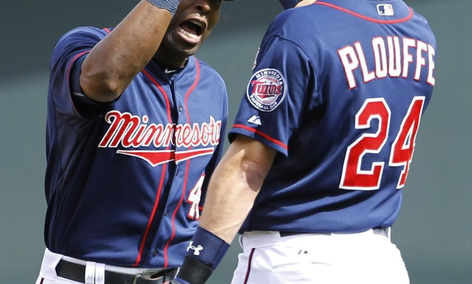 Minnesota Twins right fielder Torii Hunter, left, celebrates with third baseman Trevor Plouffe (24) after the Twins defeated the Toronto Blue Jays 6-5 in a baseball game in Minneapolis, Sunday, May 31, 2015. (AP Photo/Ann Heisenfelt)
